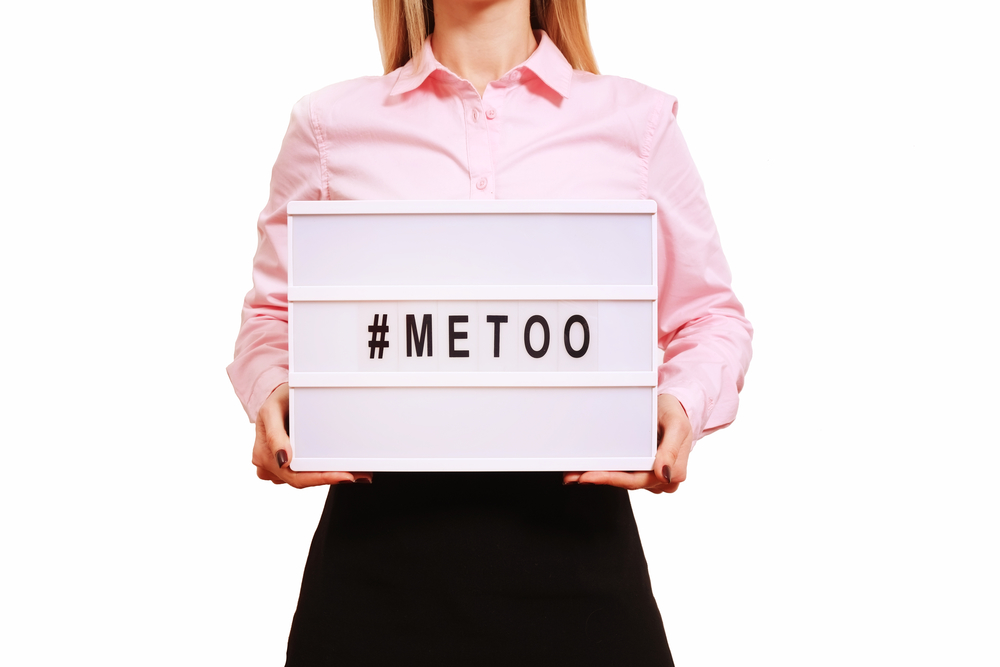 '#METOO' text in woman's hands. Female empowering movement concept.